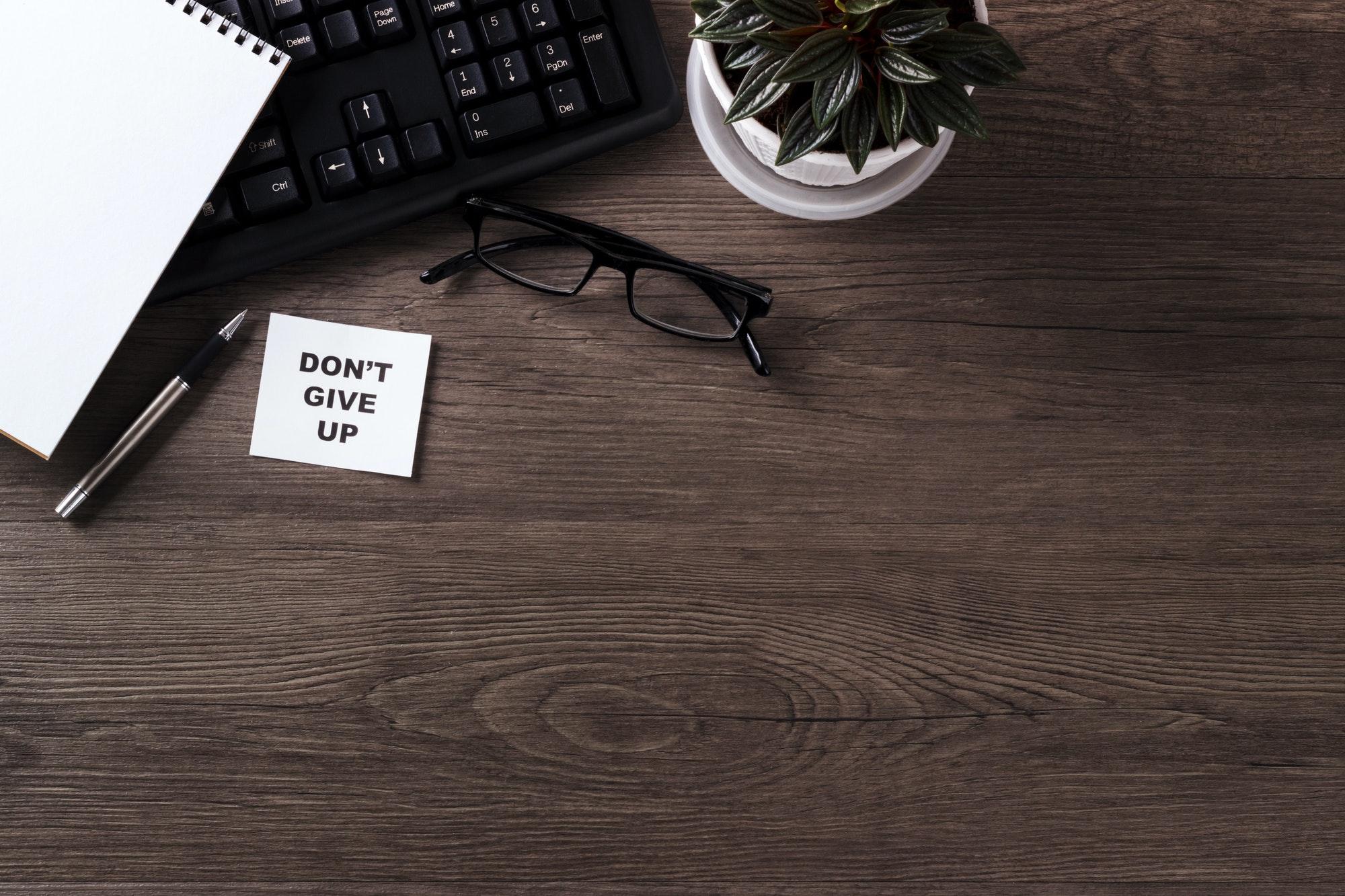 Modern office desk with motivation note